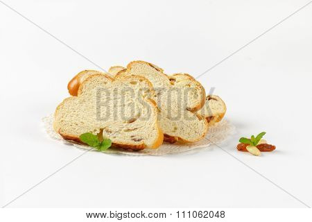 slices of sweet braided bread on lace place mat
