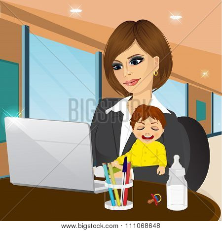 focused mother working on laptop in cafe