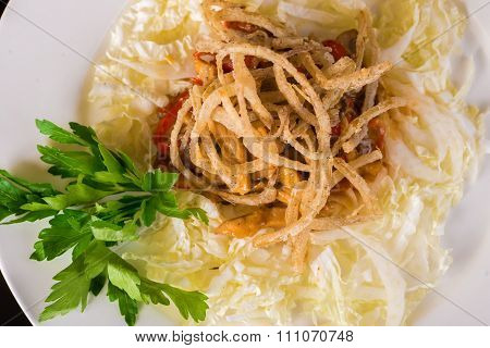 Chinese cabbage and onion salad close up