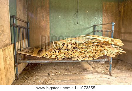 Bed With Dumped Planks.