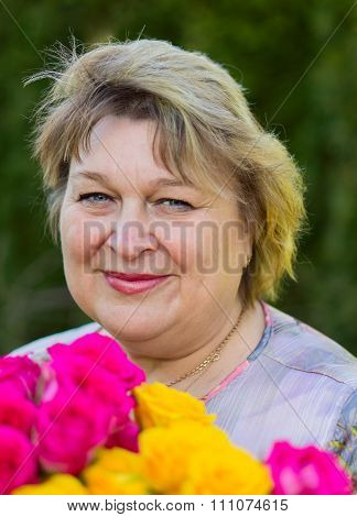 Mature Woman In A City Park