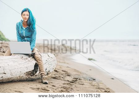 Working On Laptop Near The Sea