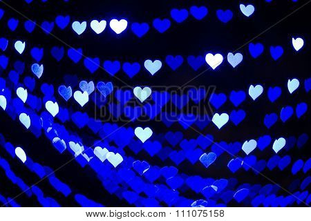 White, blue hearts bokeh blur lights.