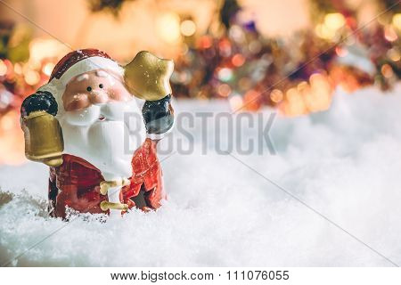 Santa claus hold the bell and star stand among pile of snow at silent night,  light up the hopefulne