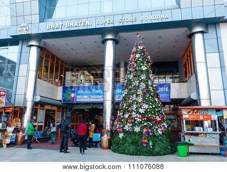 KATHMANDU, NEPAL - DECEMBER 11, 2015: A Christmas tree decorates the entrance of Bhat-Bhateni Super Store Bouddha.