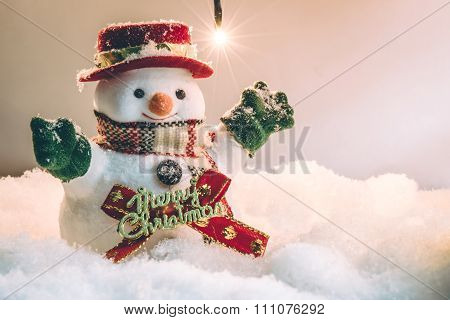 Snowman and light bulb stand among pile of snow at silent night, light up the hopefulness and happin