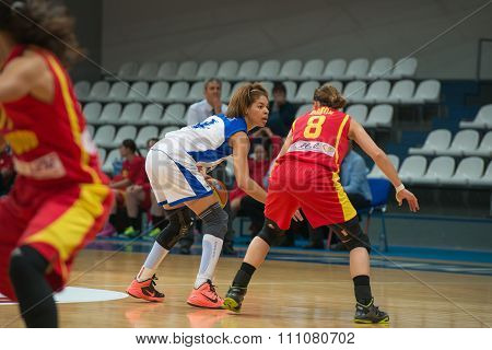 MOSCOW -- DECEMBER 4, 2014: Katerina Keyru (4) atack on the International Europe bascketball league match Dynamo Moscow vs Maccabi Ashdod Israel in sport palace Krilatskoe, Moscow, Russia. Dynamo loss 59:67