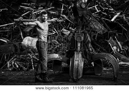 Muscular Man Working On Junkyard