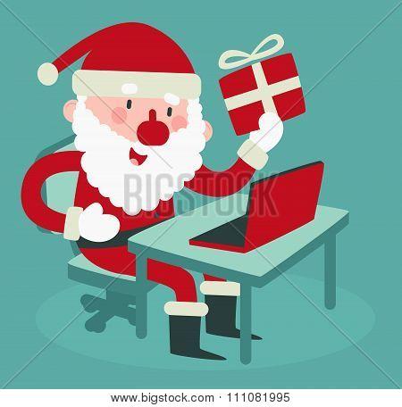 Cute Santa Holding A Gift At The Computer