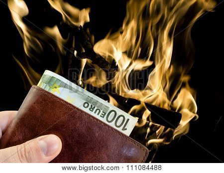 Giving Bribe From Brown Leather Wallet With One Hundred Euro With Burning Fire Isolated On Black