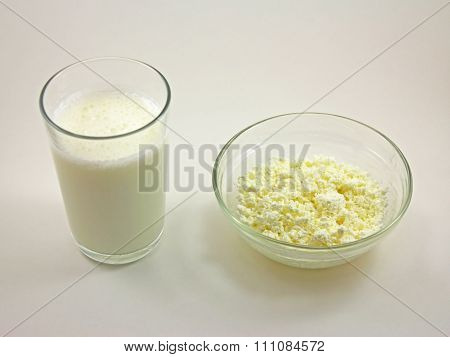Cottage Cheese And Kefir On White Background