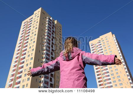 Little Girl In Pink Jacket Standing Back To Camera, Multi-storey Yellow House