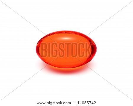 Red transparent supplement capsule isolated on white background