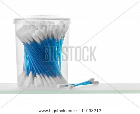 Cotton swabs on shelf close up, isolated