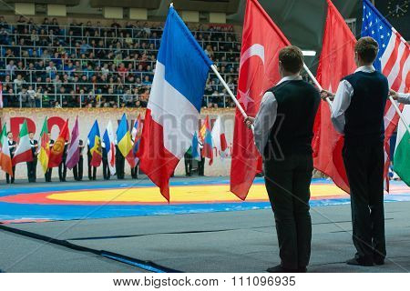 Stadium Druzhba. A Solemn Parade Of Flags Of Participating Countries Of T