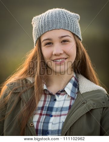 Teen Girl Wearing Hat And Smiling In Camera