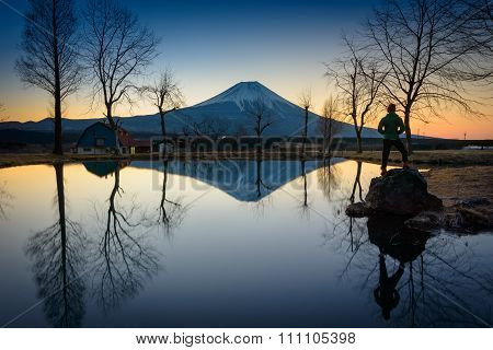 Sunrise landscape view with reflection of Fuji mountain in morning.