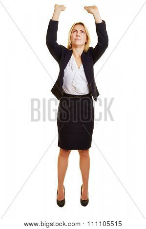 Young woman lifting heavy imaginary object over her head