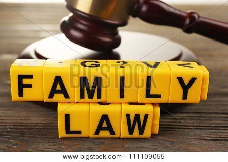 A gavel and blocks regarding child-custody and divorce concept
