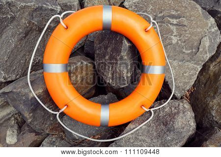 A life buoy on stones background