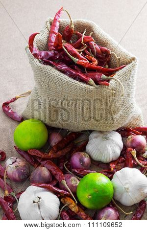 Thai's Food Ingredients (lemon, lime, dried chilli, garlic ,shallot) on woody background.