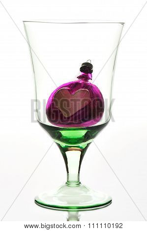 Glass With Toy On White Background
