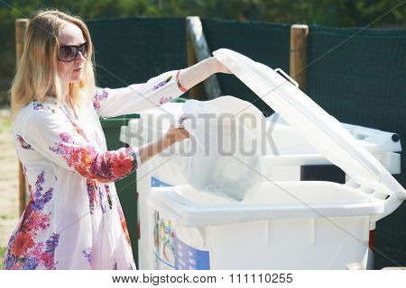 Recycling - garbage separation. woman throwing empty plastic into the trash