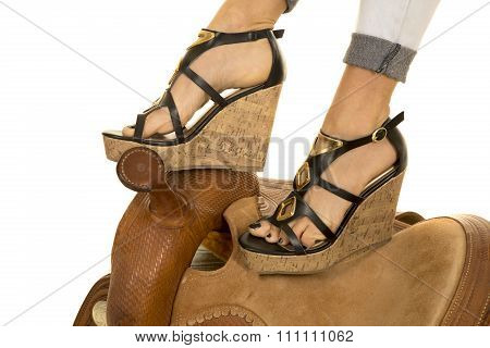Womans Feet In Heels On A Saddle