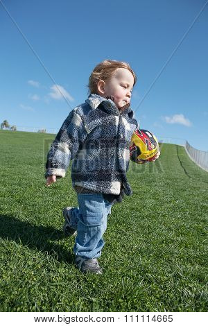 Young Boy With Toy Soccer Ball