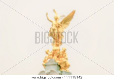 Defocused Background Of Golden Statue At Buckingham Palace, London