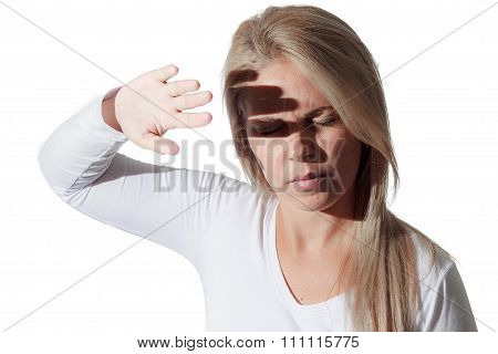 Photophobia. Woman Protects Her Eyes From Bright Light With Your Hands.