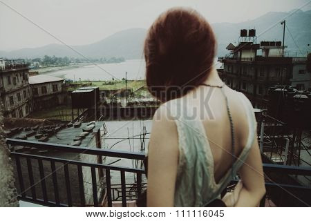 Beautiful Woman On The Roof