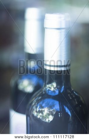 Red Wine Bottle In Retail Store Window Display
