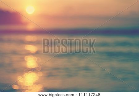 Blur Tropical Sunset Beach With Bokeh Wave Sun Light Abstract Background.