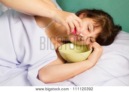 Woman Flushing Her Nose.