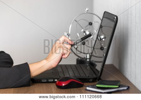 Business woman pointing at laptop screen to re-check information and data. conceptual of people at working place.