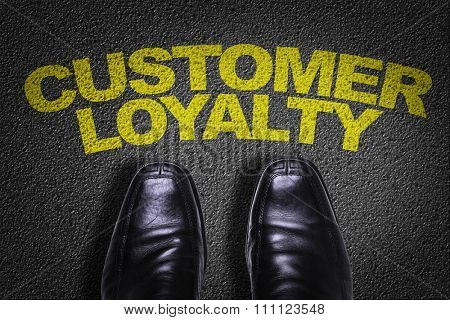 Top View of Business Shoes on the floor with the text: Customer Loyalty
