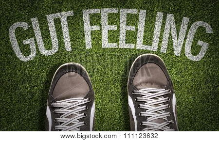 Top View of Sneakers on the grass with the text: Gut Feeling