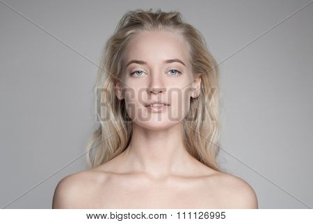 Magnificent portrait of a beautiful young blond woman with perfect skin.