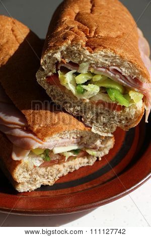 Cose-up of Club submarine sandwich cut in two.