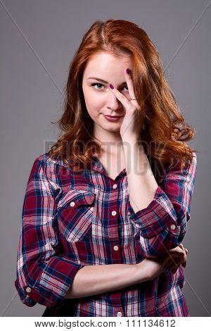 Pensive Redhead Peeking Through His Fingers While