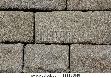 Granite blocks of ancient Roman aqueduct in Segovia, Spain