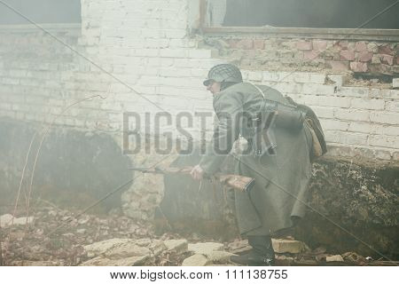 Unidentified re-enactor dressed as german wehrmacht soldier runs