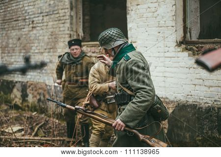 Unidentified re-enactor dressed as german wehrmacht soldier surr