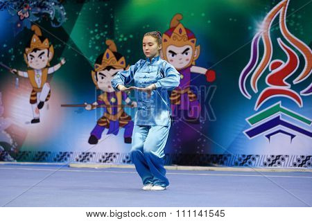 JAKARTA, INDONESIA - NOVEMBER 16, 2015: Diana Traize of Kazakhstan performs her movements in the Women's Baguazhang event at the 13th World Wushu Championship 2015 at the Istora Senayan Stadium.