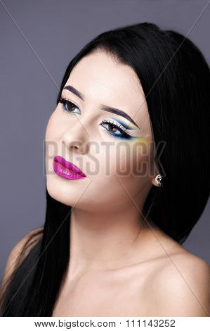 Beautiful Fashion Luxury Makeup, long eyelashes, perfect skin facial make-up. Beauty Brunette model