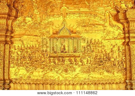 LUANG PRABANG, LAOS - MARCH 1: Gold Carving Wall of Temple on March 1, 2013 in Luang Prabang.
