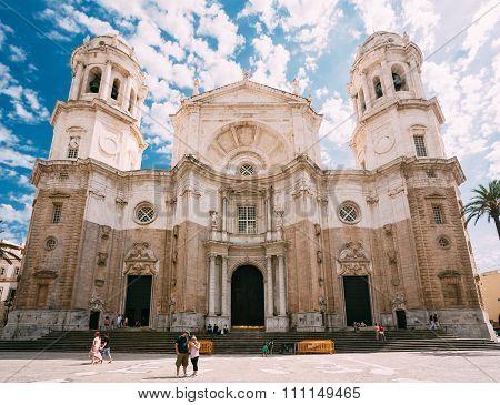People walking near Cathedral in Cadiz, Spain.