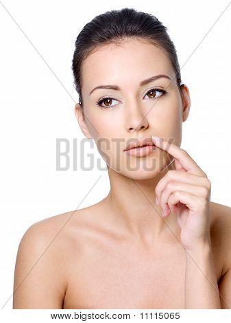 Calm Beautiful Woman Touching Her Lips