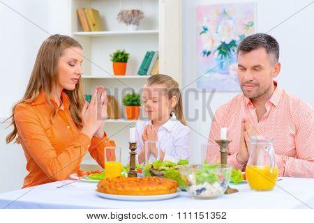 Friendly family having dinner together